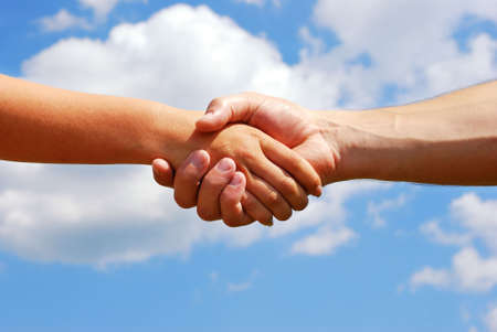A man and woman shaking hands Stock Photo