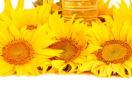 Sunflowers and  bottle with sunflower oil isolated on white background Stock Photo - 5904339