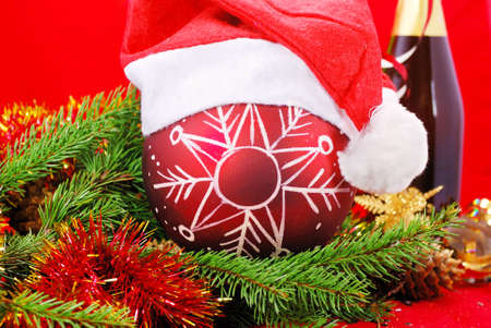 attribute: Christmas ornament with branch of a christmas tree