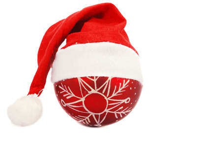 Santa christmas hat and sphere isolated on white