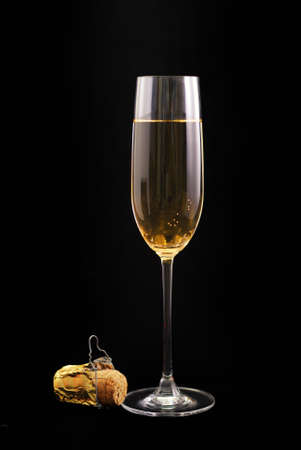 Champagne glass with cork on black background Stock Photo
