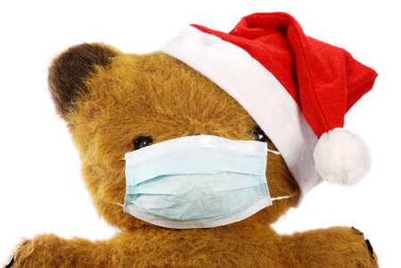 Teddy bear wear mask as protection again the influenza virus. photo