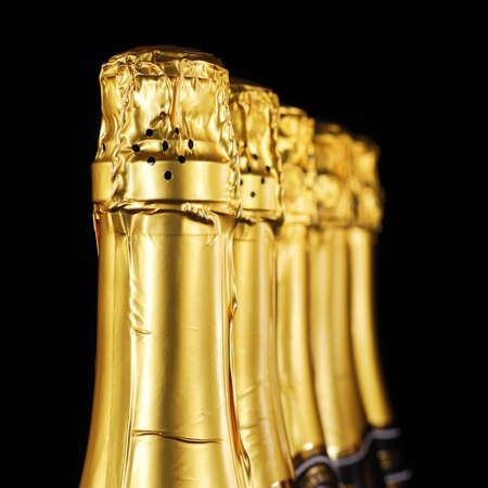Champagne bottles in gold foil