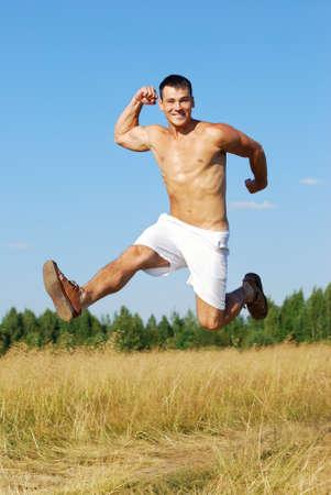 Young adult enjoying  running training