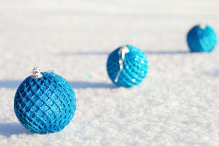 adorn: Christmas and New Year decoration - color balls on snow background