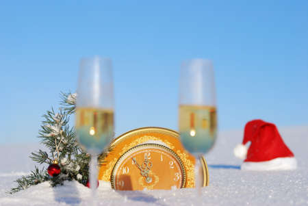 Glasses of  champagne out of focus on  snow against christmas background photo