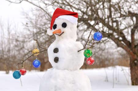 Scene with  snowman on  winter garden Stock Photo - 8090721