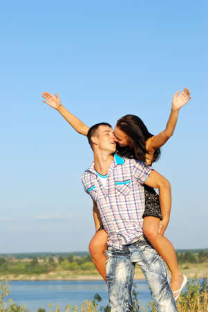 Close-up of  young couple loving on coast of  river Stock Photo - 10358783