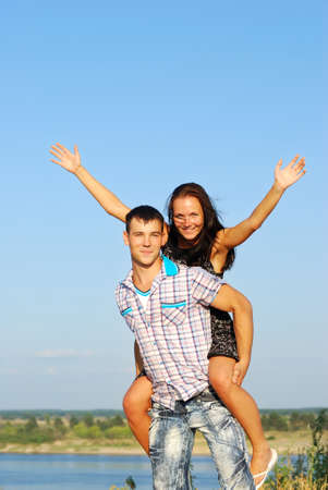 Close-up of  young couple loving on coast of  river Stock Photo - 10358782