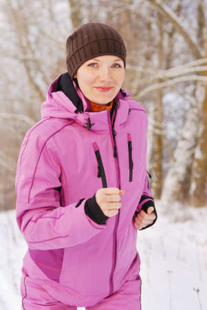 Young attractive girl running on a cold winter day Stock Photo