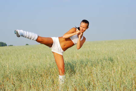 Young attractive woman doing morning sports exercises photo