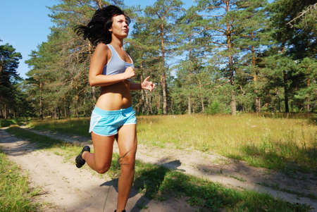 running race: Young attractive girl running on the morning Stock Photo