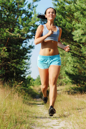 woman running: Young attractive girl running on the morning Stock Photo