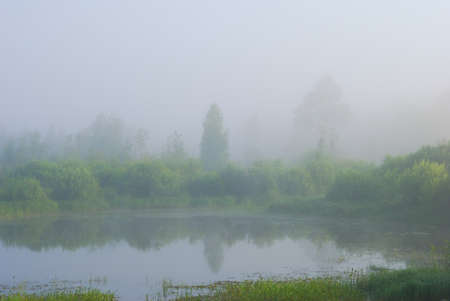 Shoot of misty morning sunrise on small pond Stock Photo