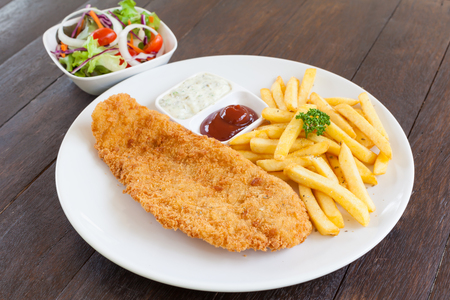 things that go together: Fish and chips on white plate