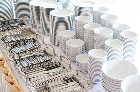 Group of white plates stacked together in a hotel.