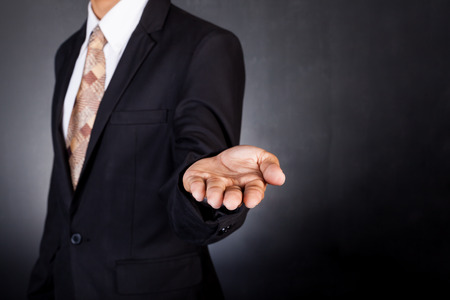man in suite: Businessman empty open cupped hands. Concept of giving or holding