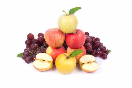 mixed set of fresh raw ripe fruits apple grape on isolated white background