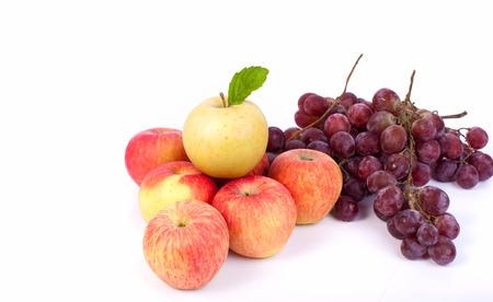 mixed set of fresh raw ripe fruits apple grape on white background