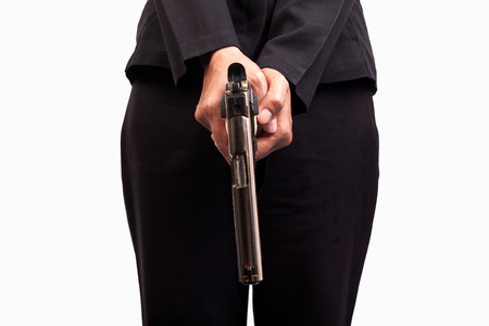 Close up of woman in business suit holding a gun