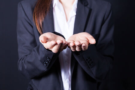 business woman holds a handful, hands together, asks Banque d'images