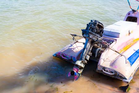Old Jet-ski parked on water
