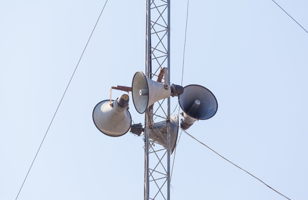 soundsystem: Out door loudspeakers against the sky.