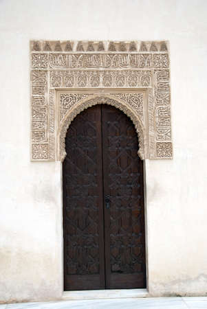 A beautiful wooden door inside the Alhambra in Granada, Spain  photo