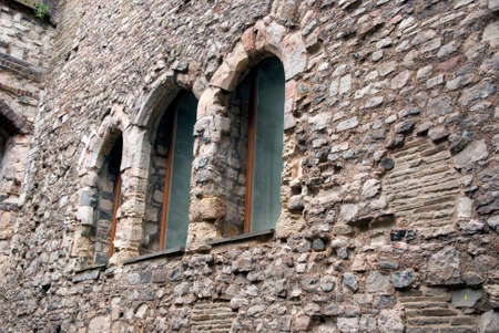 Windows on an old wall from an historic house photo