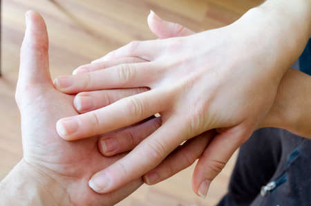 gratifying: Friendly handshake  Man and woman shaking hands as welcoming gesture  Stock Photo