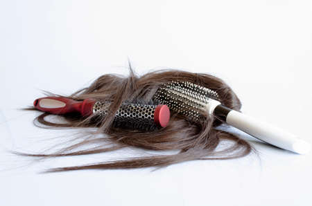 hairbrush with hair background concept hair loss and healthy Hair photo