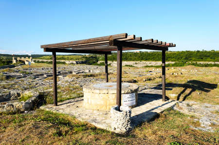 draw well: Old stone draw well for obtaining water Stock Photo