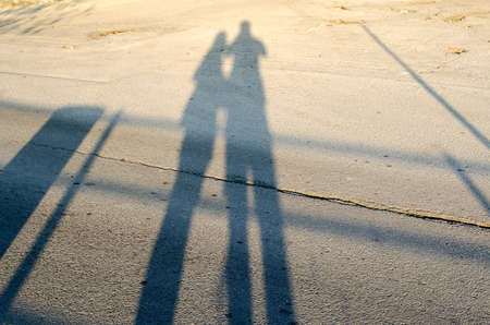 Man and Woman love silhouette in sunset photo