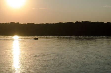 sunset on the Danube river and boat photo