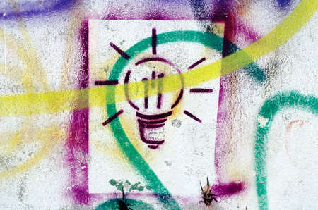 Colorful splatter lightbulb drawing on the wall photo