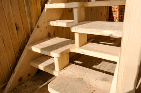 Incomplete Architectural Wooden Interior Design with Stairs photo
