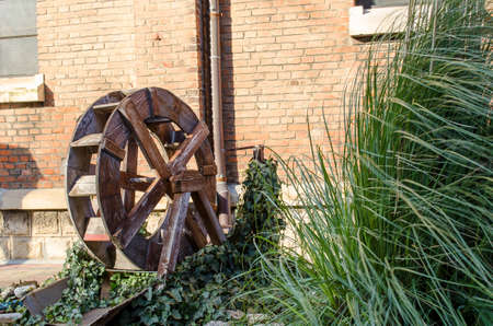 old grist mill: Wooden wheel of an old water mill Stock Photo