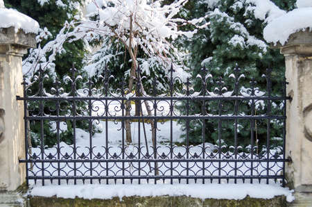 penal: Snow cover rusty old fence closeup view
