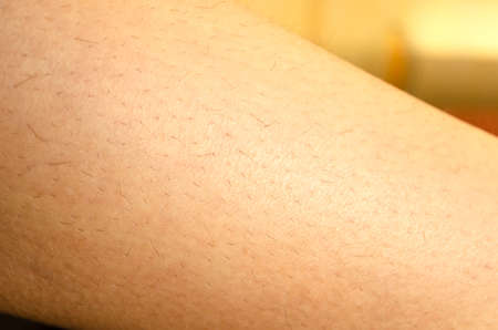 One woman hairy leg closeup view