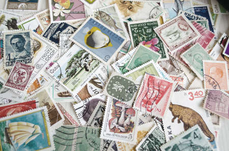 postage stamps: Backdrop of old worldwide postage stamps .