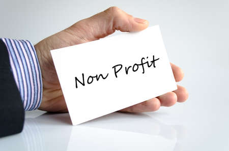non: Non Profit note in bussines man hand - business concept Stock Photo