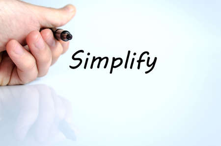 Human hand writing Simplify isolated over white background - business concept photo