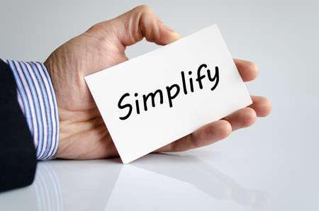 vereenvoudigen: Bussines man de hand schrijven van Simplify - business concept