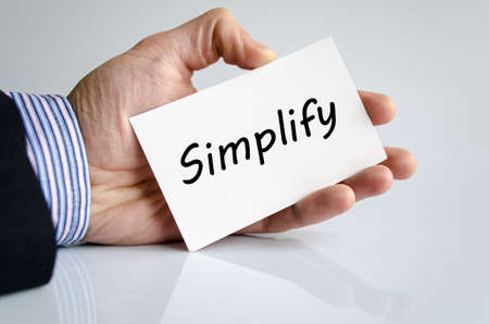 clarify: Bussines man hand writing Simplify - business concept Stock Photo
