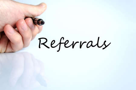 endorsement: Human hand writing Referrals isolated over white background - business concept