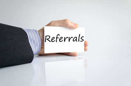 Bussines man hand writing Referrals photo