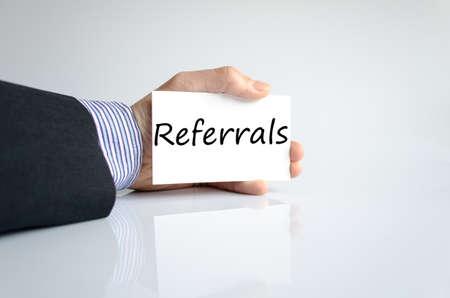 referrals: Bussines man hand writing Referrals