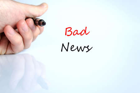 stress testing: Pen in the hand isolated over white background and text concept Bad News Stock Photo