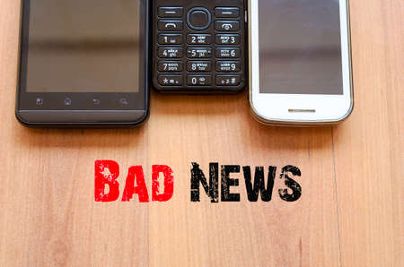 distressing: Mobile Telephones Text Concept Bad News - smartphone and old mobile telephone Stock Photo