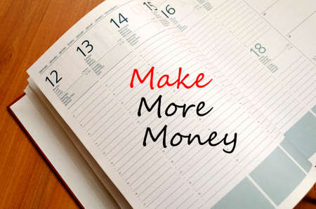 Make More Money Concept Notepad photo